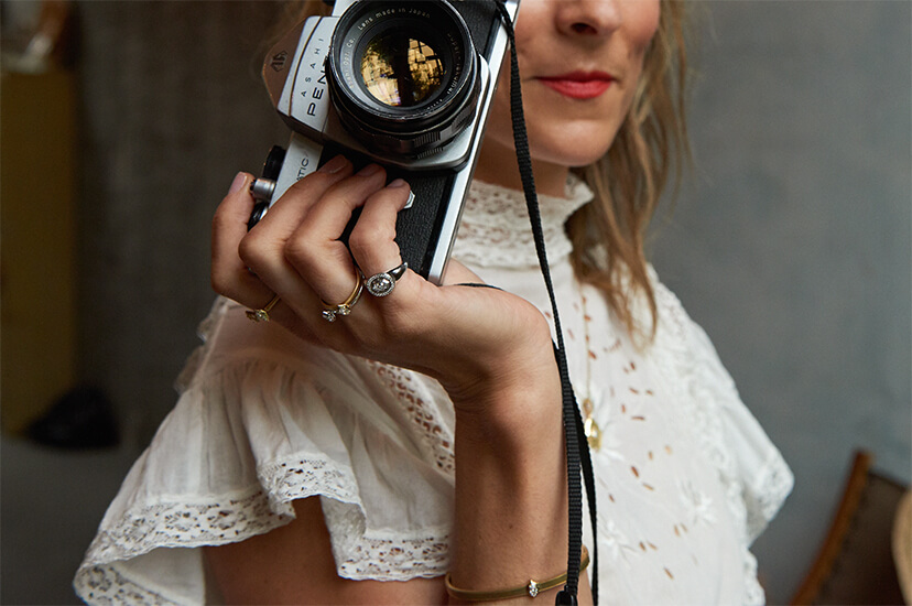 Lucy Laucht holding a camera