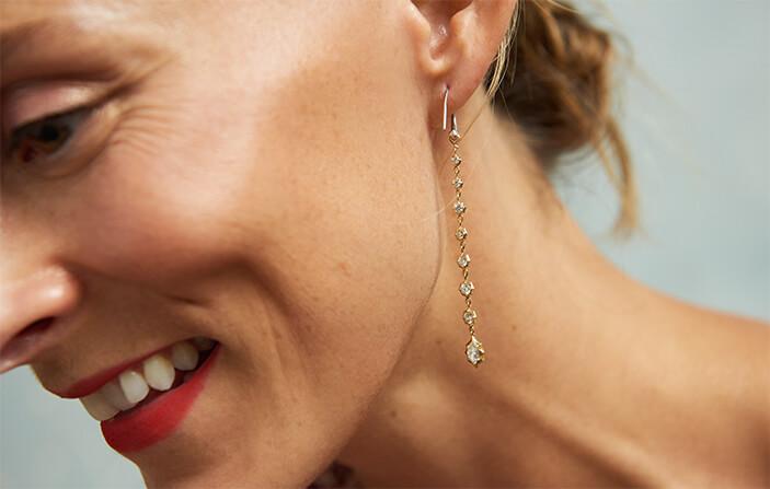 Lucy Laucht wearing earrings