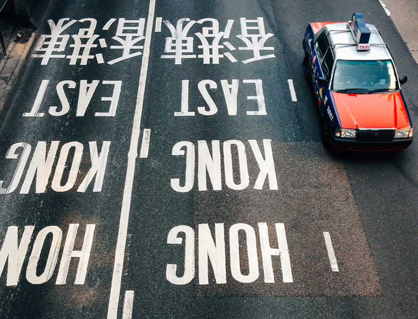 Taxi Driving on Wide Street in Hong Kong
