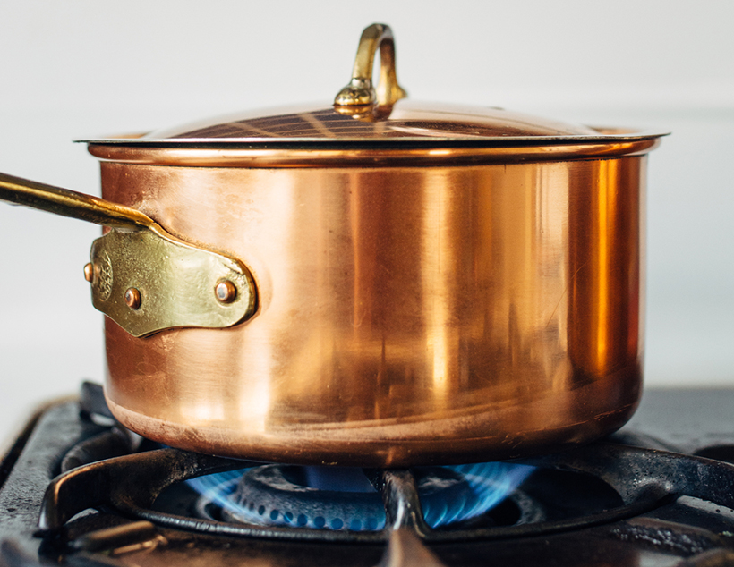 Copper pot on a retro stove