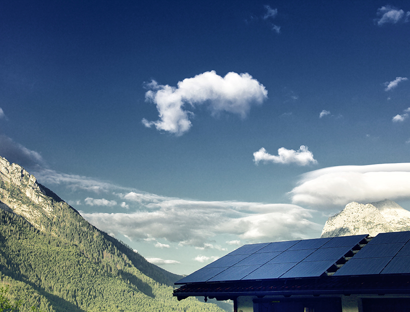 Solar panel on roof top overlooking mountains