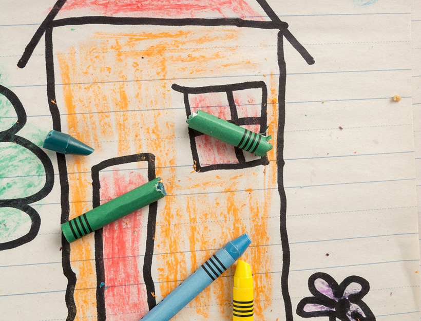 Child's drawing of house with crayon over it