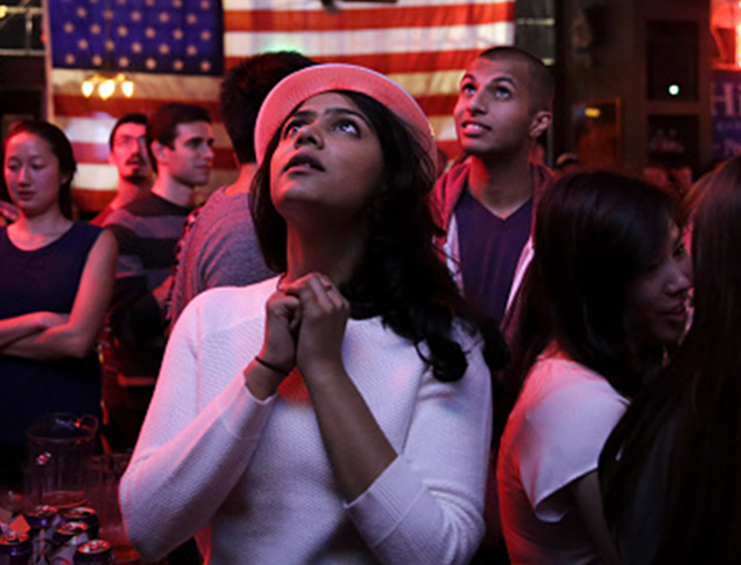 Sri Vasamsetti, 22, of Seattle and a supporter of Democratic presidential candidate Hillary Clinton, watches televised coverage of the US presidential election at the Comet Tavern in the Capitol Hill neighborhood of Seattle, Washington on November 8, 2016.  / AFP / Jason Redmond        (Photo credit should read JASON REDMOND/AFP/Getty Images)