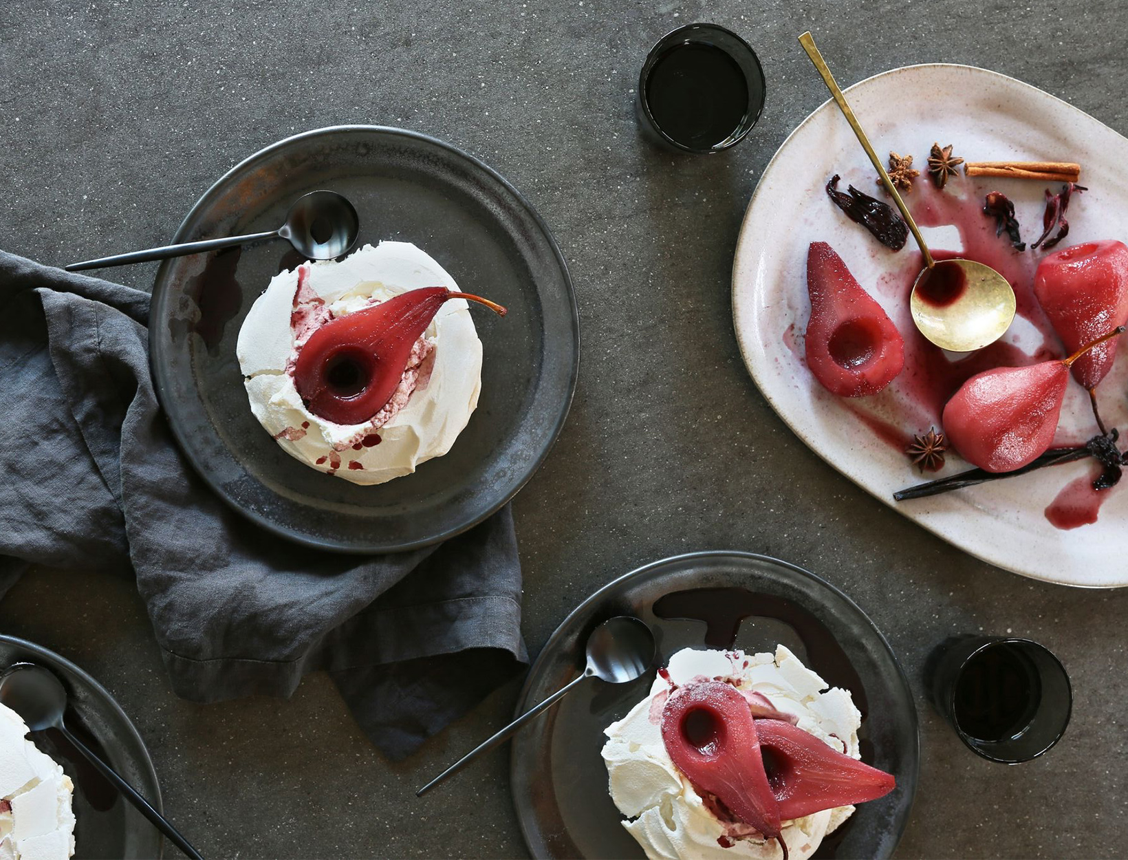 Satsuma and Red Wine Poached Pears Over Vanilla Pavlovas