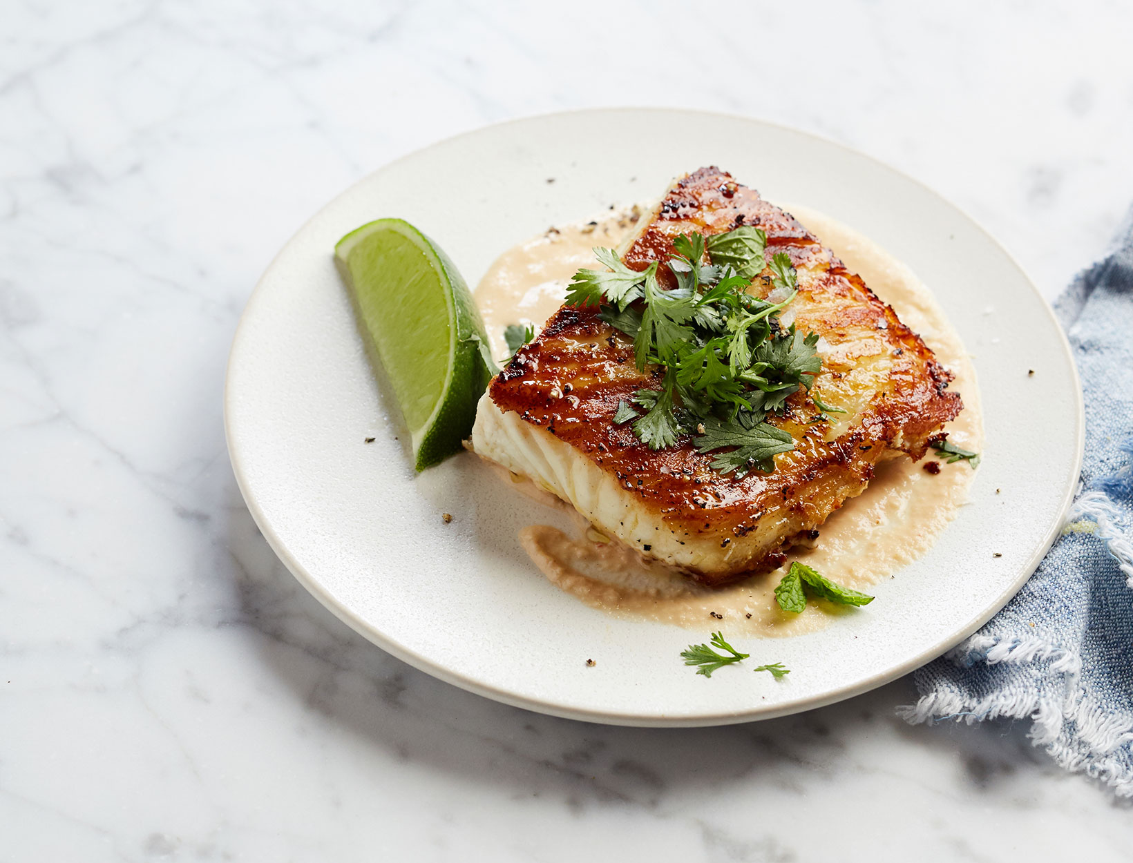 Pan-Seared Halibut with Peanut Drizzle and Herbs