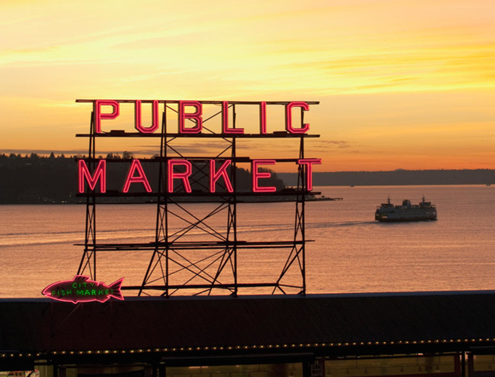 The Public Market sign at the Pike Place Market in the evening light