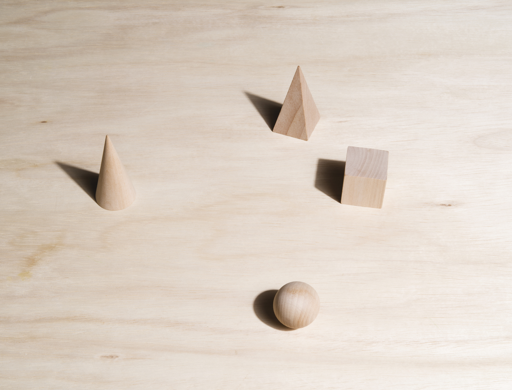 Four wooden blocks