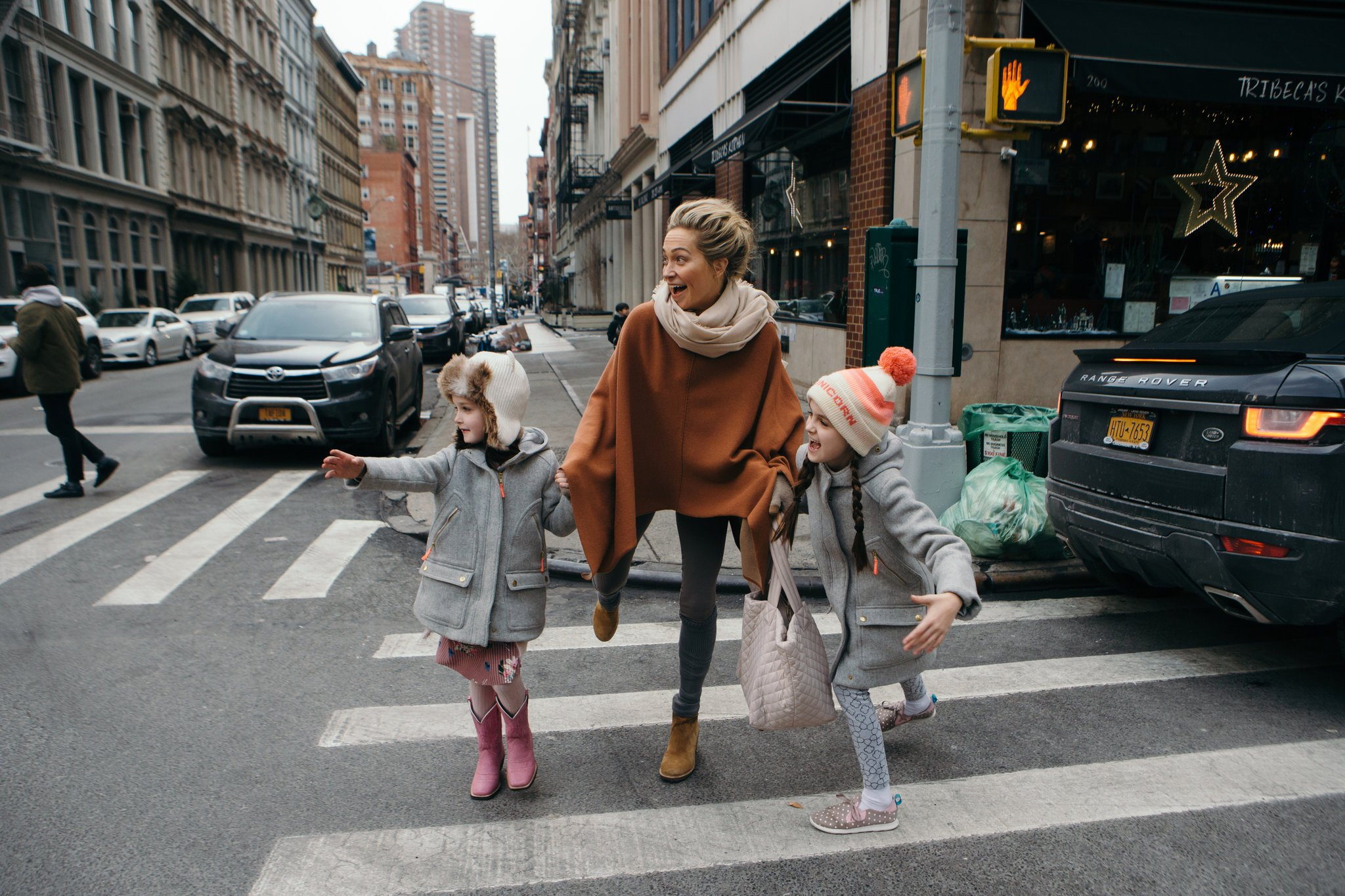 Taryn Toomey and kids crossing the street