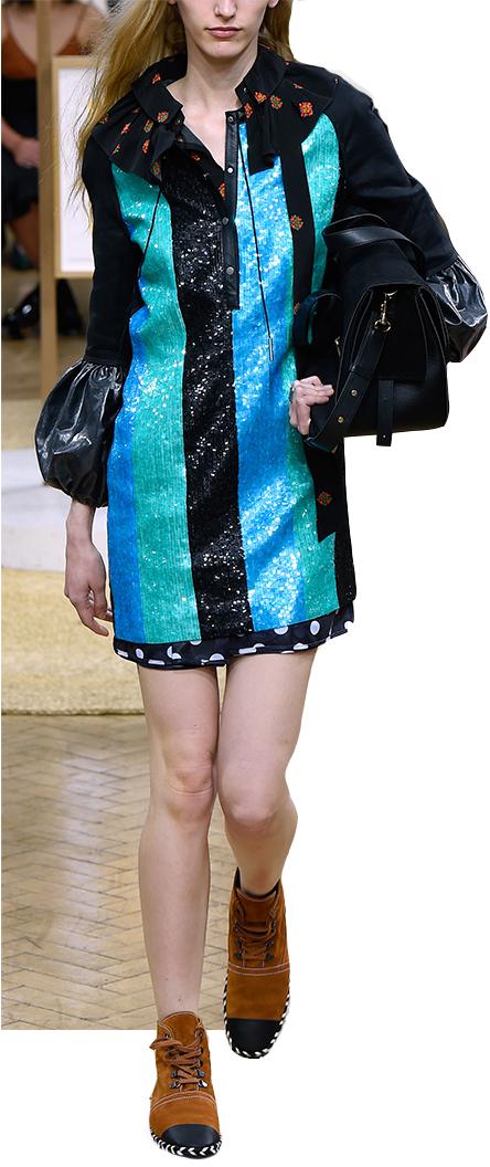Model wearing black and blue skirt.