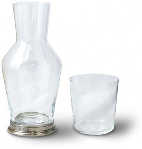 This tall glass carafe comes with a drinking glass that fits perfectly on top.