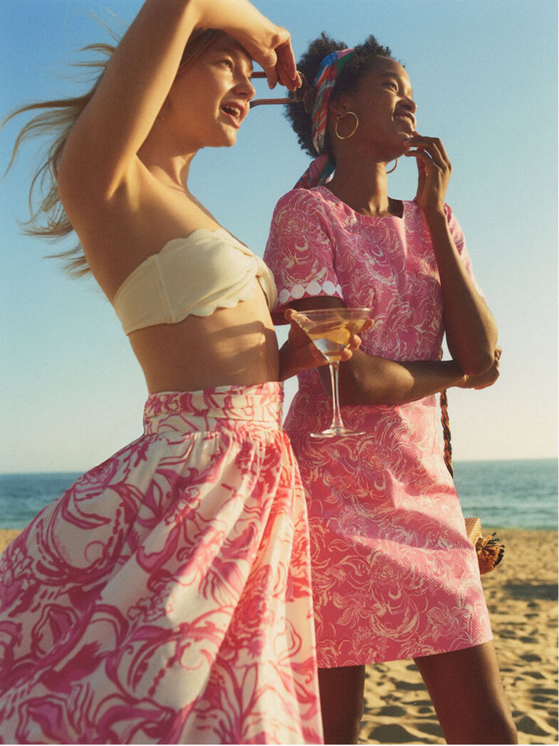 Models on the beach wearing Lilly Pulitzer x goop