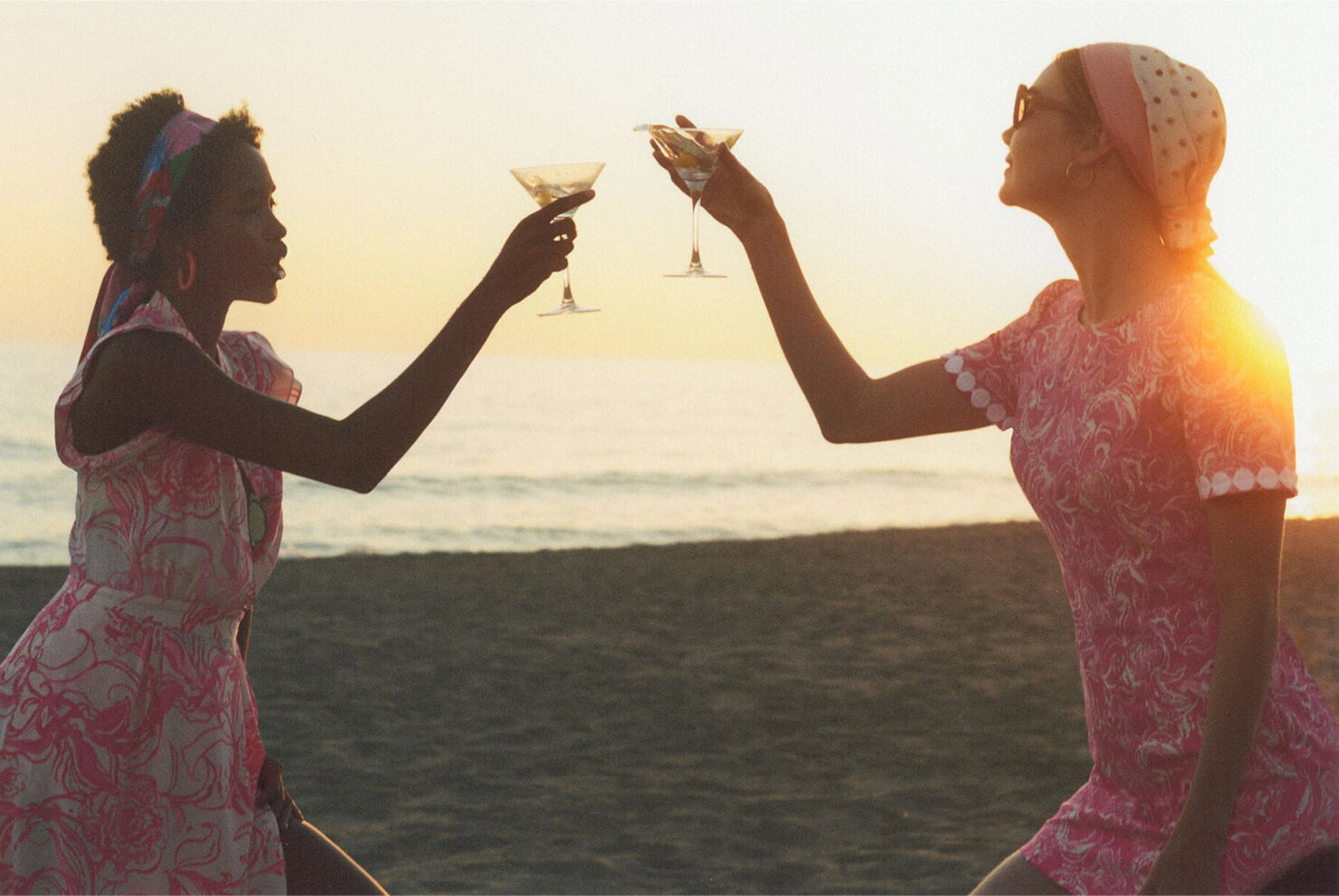 Models on the beach drinking martinis