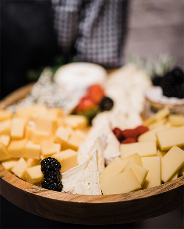 A cheese plate with berries