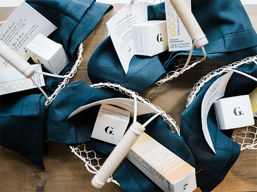Reusable bags with goop skincare products