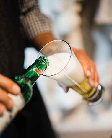 Pouring Trumer Pils for guests