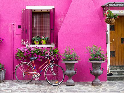 PINK BUILDING WITH BIKE PARKED IN FRONT