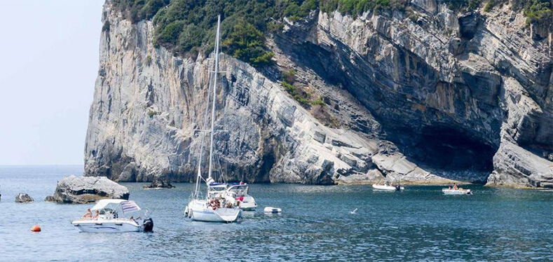 SAILBOATS IN FRONT OF ROCKFACE