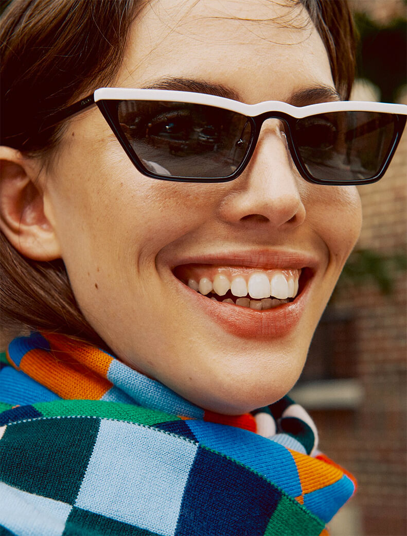 Model with small white sunglasses