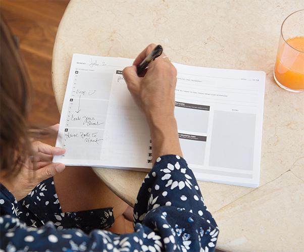 Michelle Manix writing in her planner