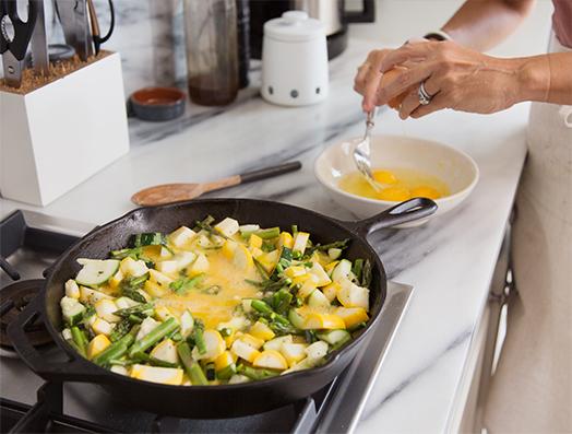 Michelle Manix making scrambled eggs for breakfast
