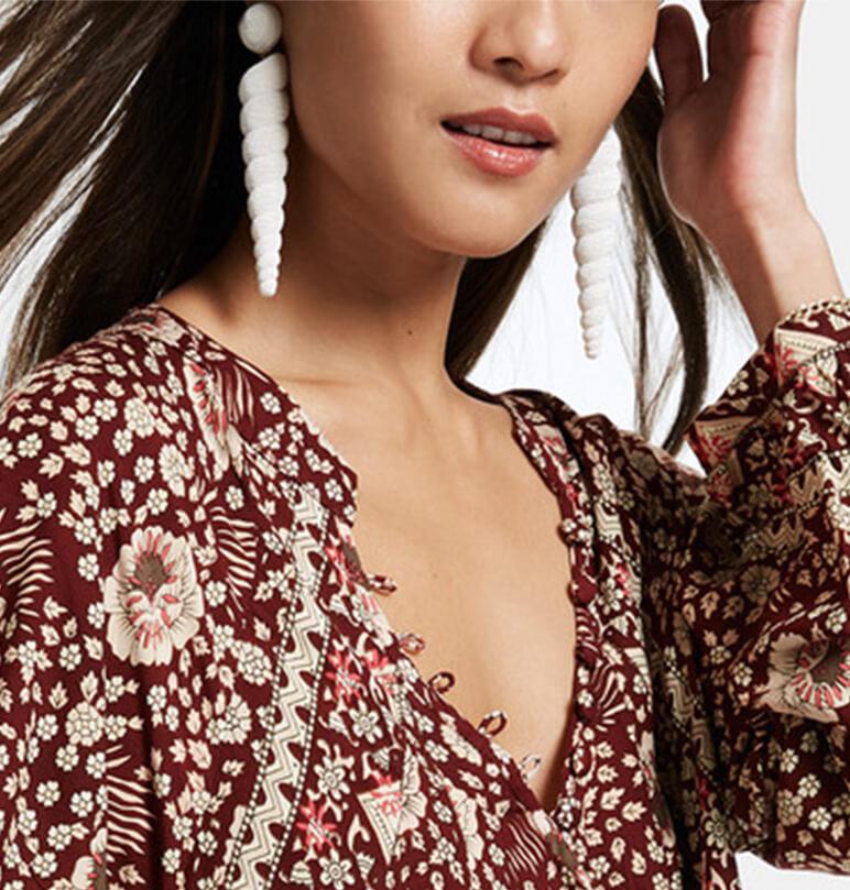 Woman wearing large white earrings