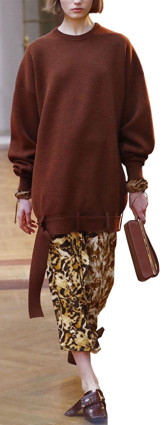 Model wearing animal print skirt and oversized sweatshirt