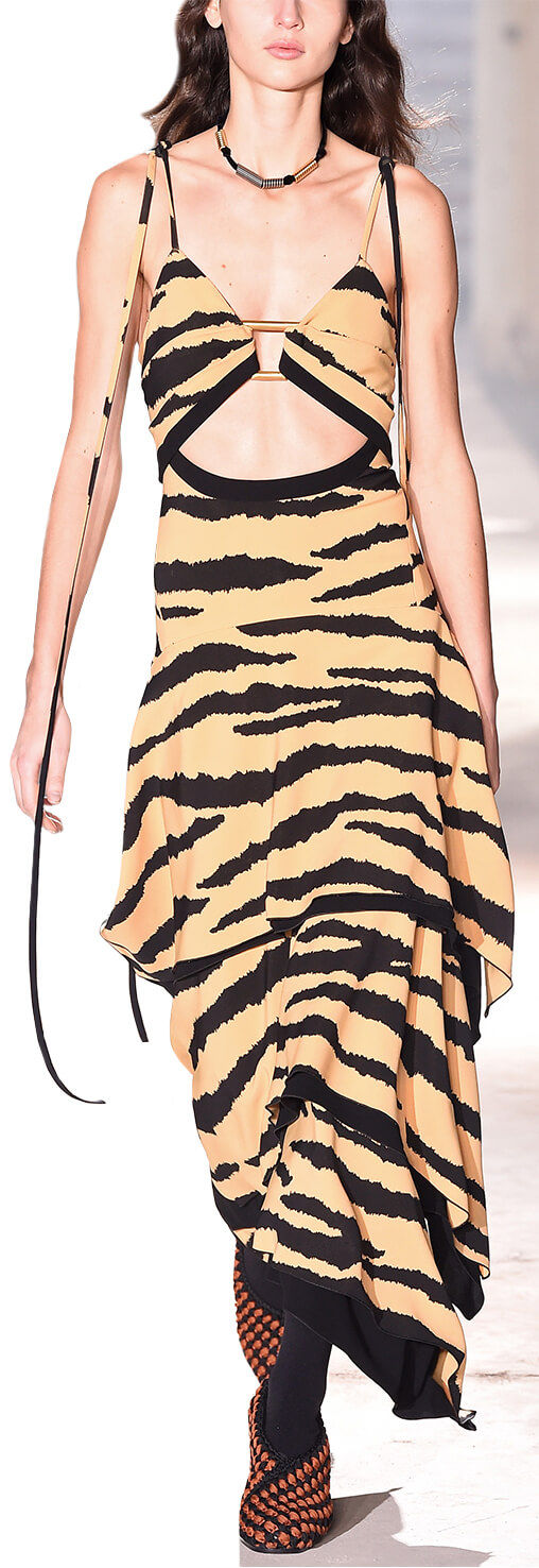 Model wearing animal print dress