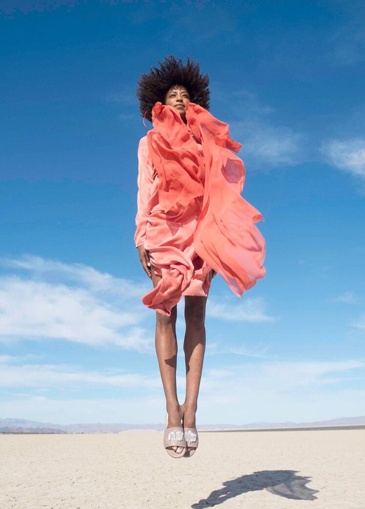 Model wearing Sahara Clear Quartz Slides
