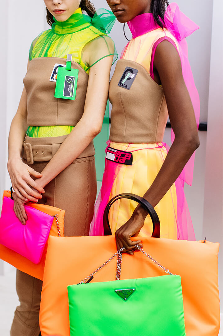 Prada Runway models with fluorescent bags