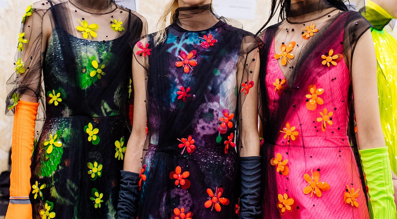 Prada models wearing flowery dress