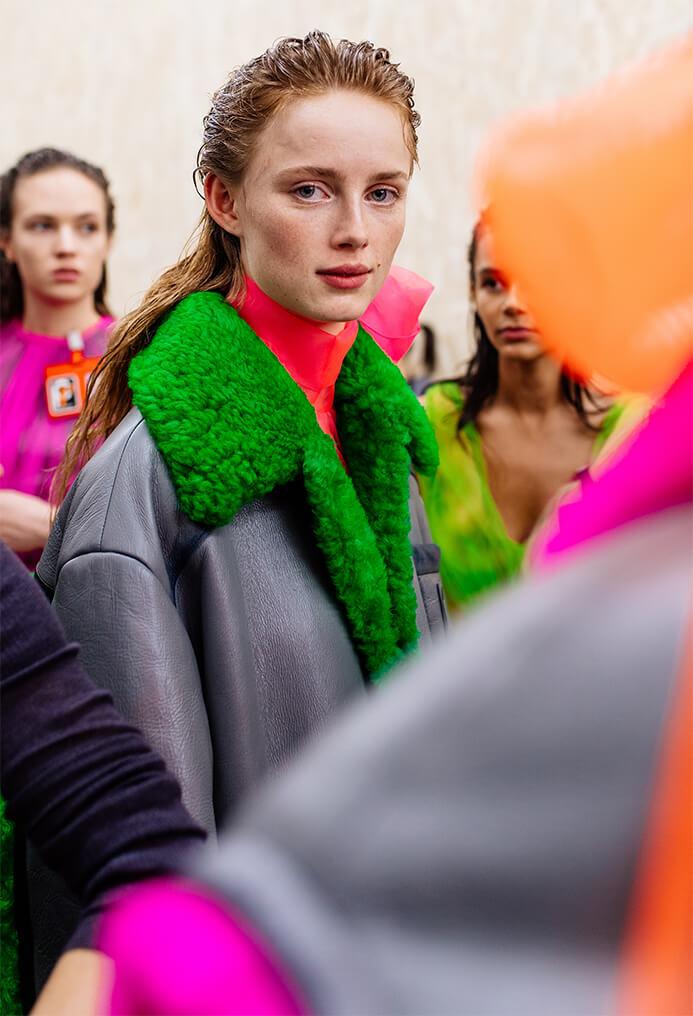 Prada model wearing a black jacket