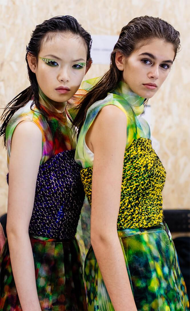 Two Prada models wearing animal prints