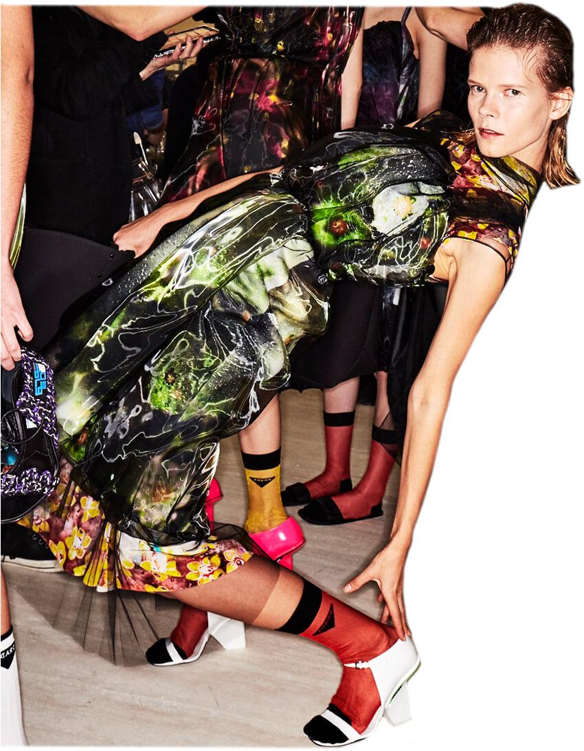Prada model highlighting shoes
