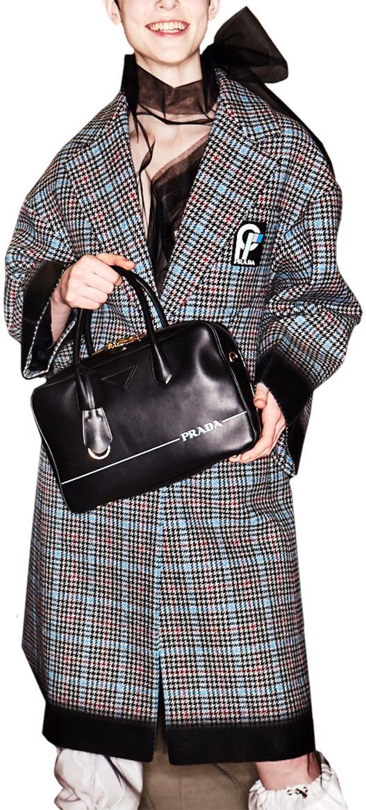 Prada model in plaid coat
