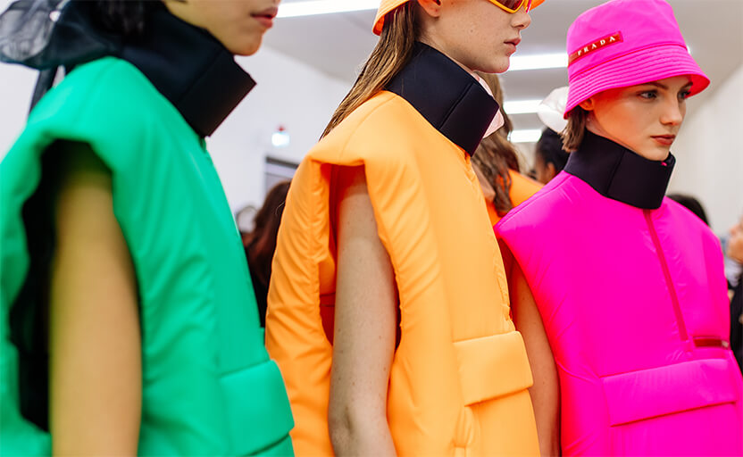 Prada models wearing neon vests