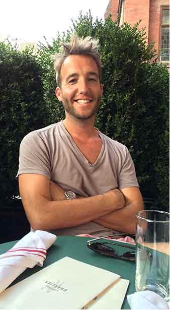 Kevin posing at a table