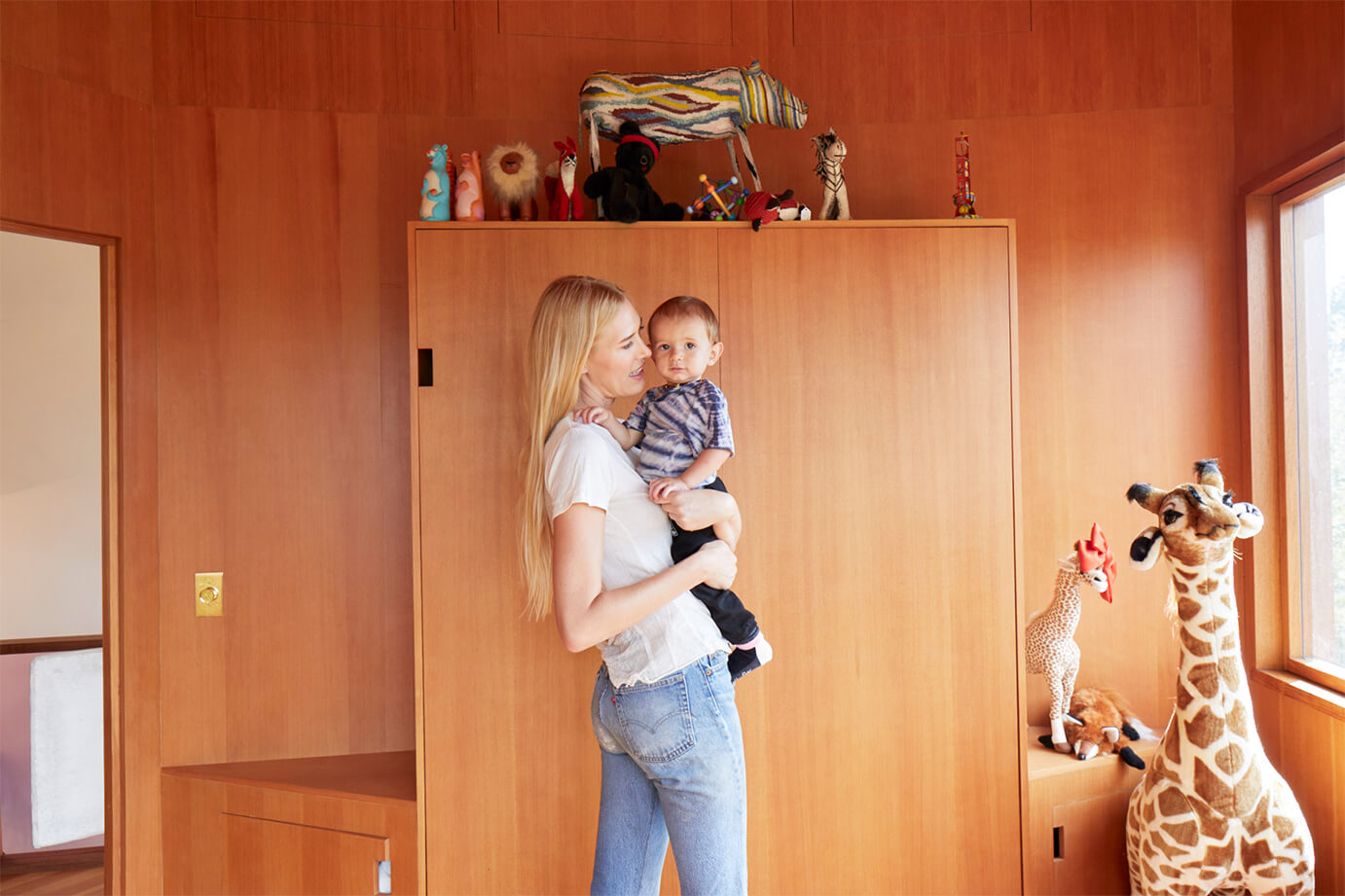 Bel Holding Baby in Bedroom