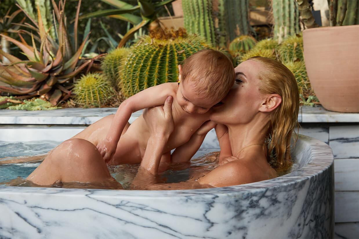 Bel Holding Baby in Bathtub