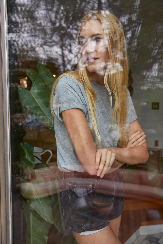 Bel Looking Through Glass Window