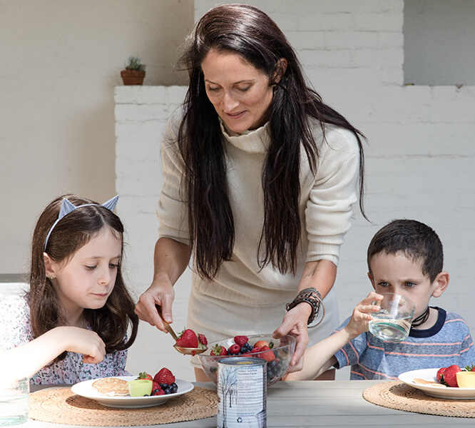 Danielle with her kids eating breakfast