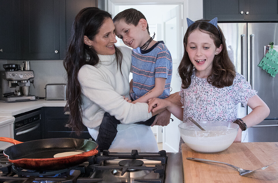 Danielle with her kids making breakfast