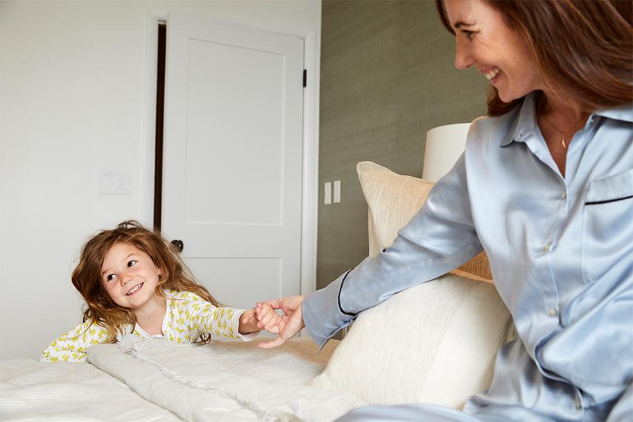 Kim Kreuzberger holding daughter's hand
