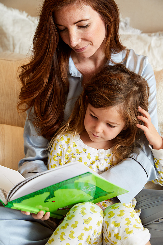 Kim Kreuzberger reading to her daughter