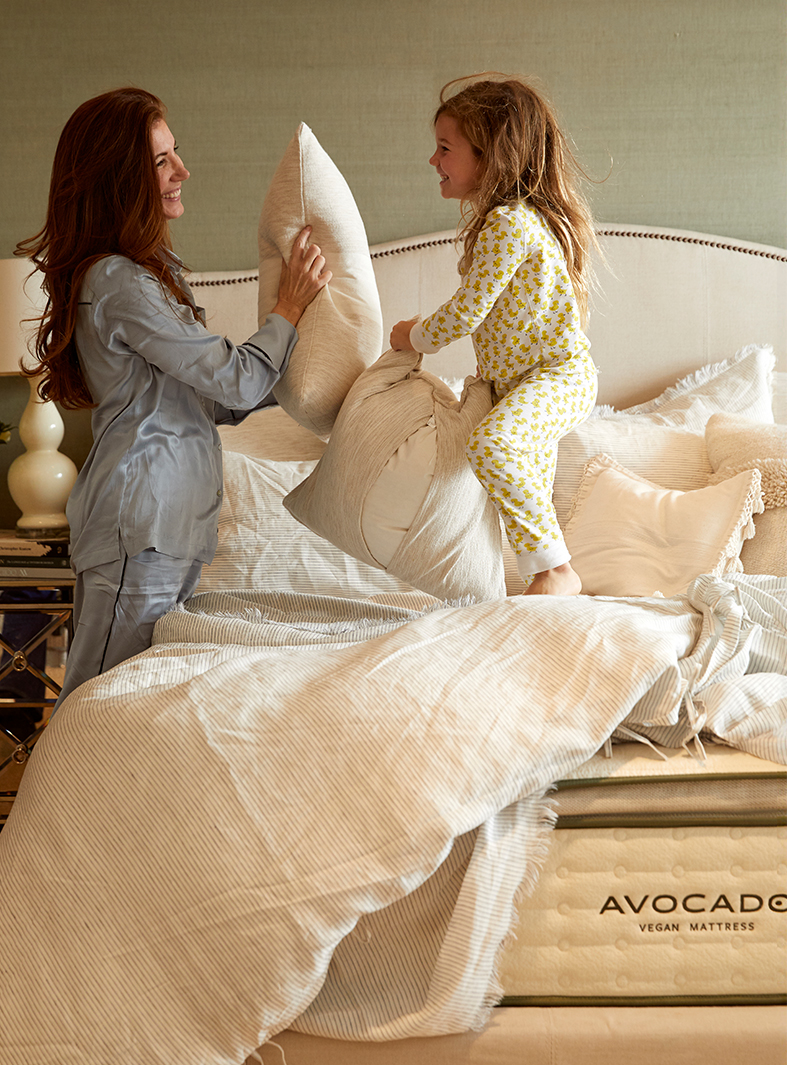 Kim Kreuzberger pillow-fighting with daughter