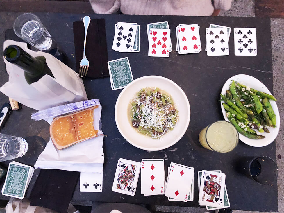 Cards and Wine Bottle on a Table