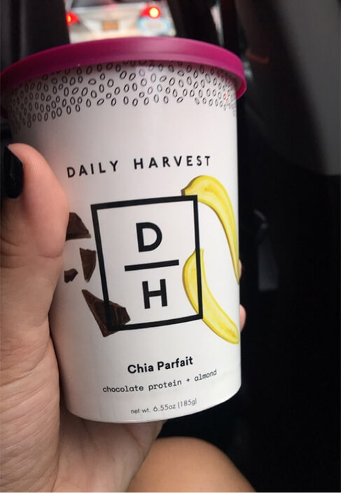 Daily harvest cup in hand