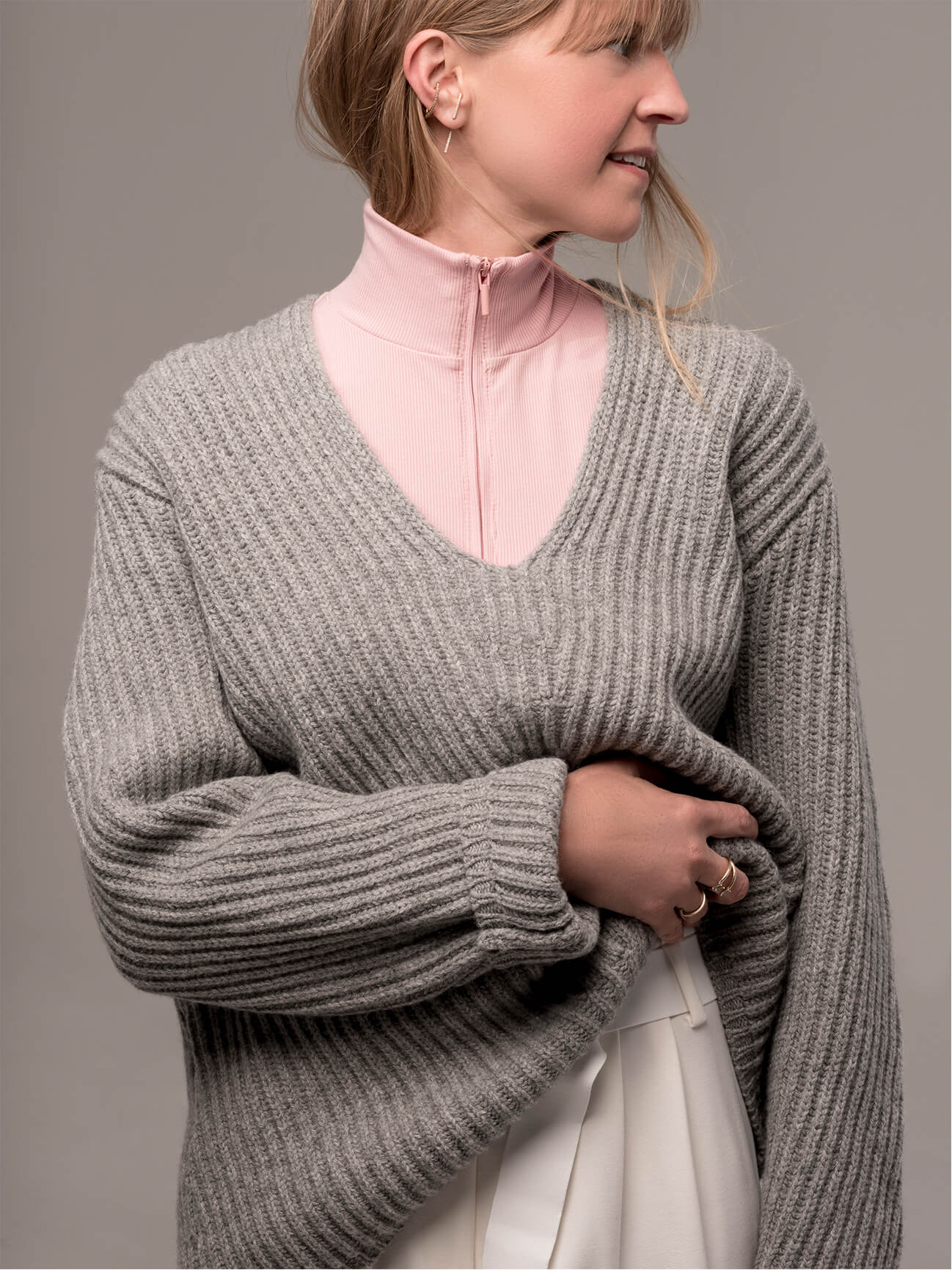 Parsons in grey sweater and pink vince turtleneck