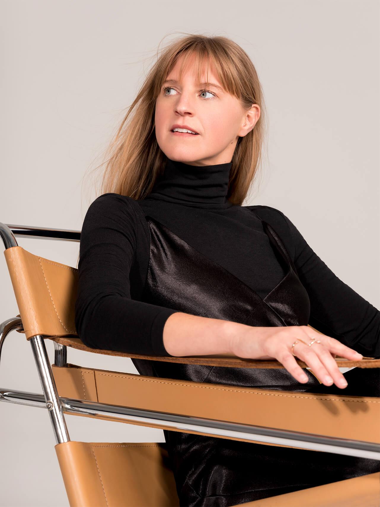 Parsons in BLACK bodysuit and black vince dress