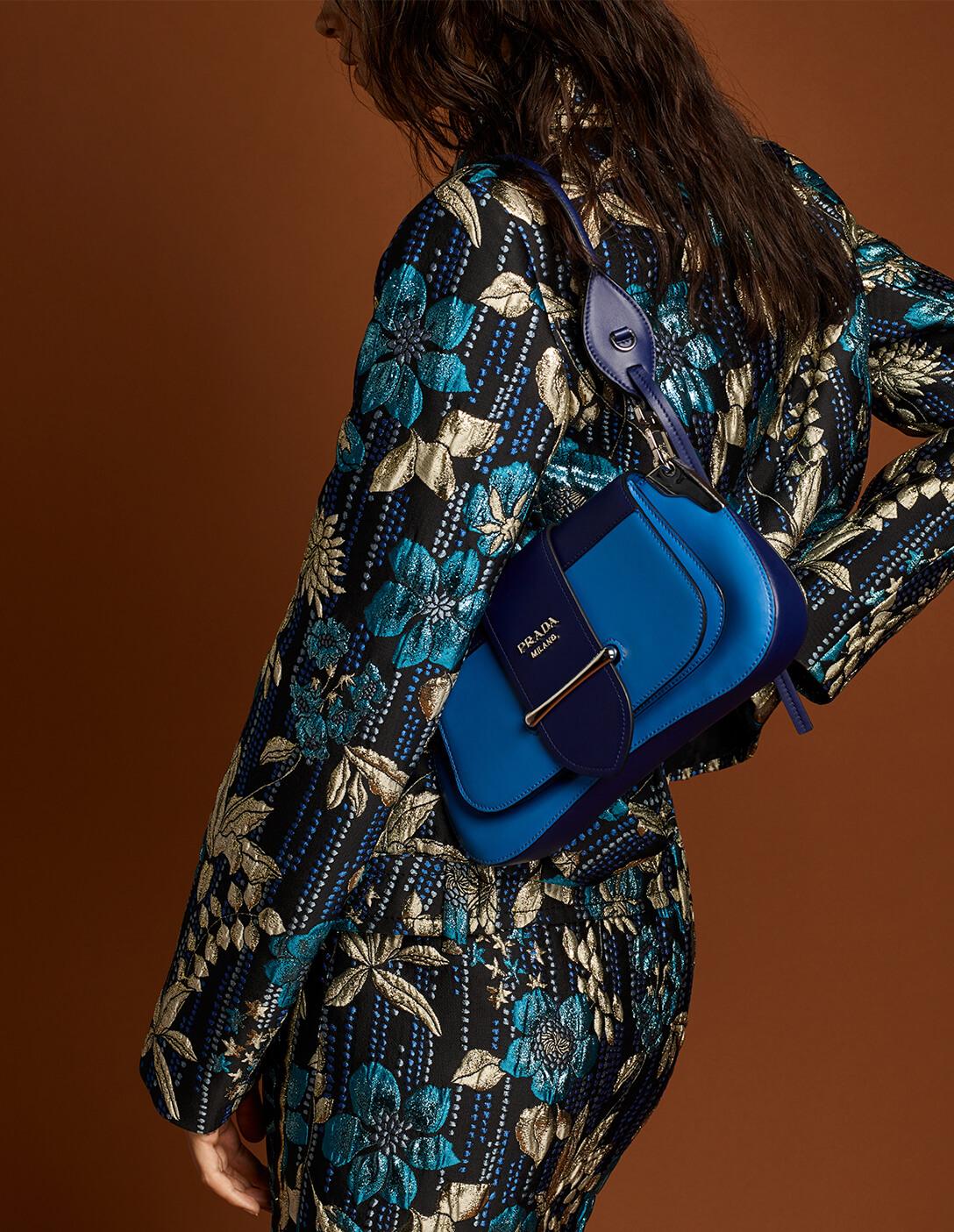 Prada model with blue bag