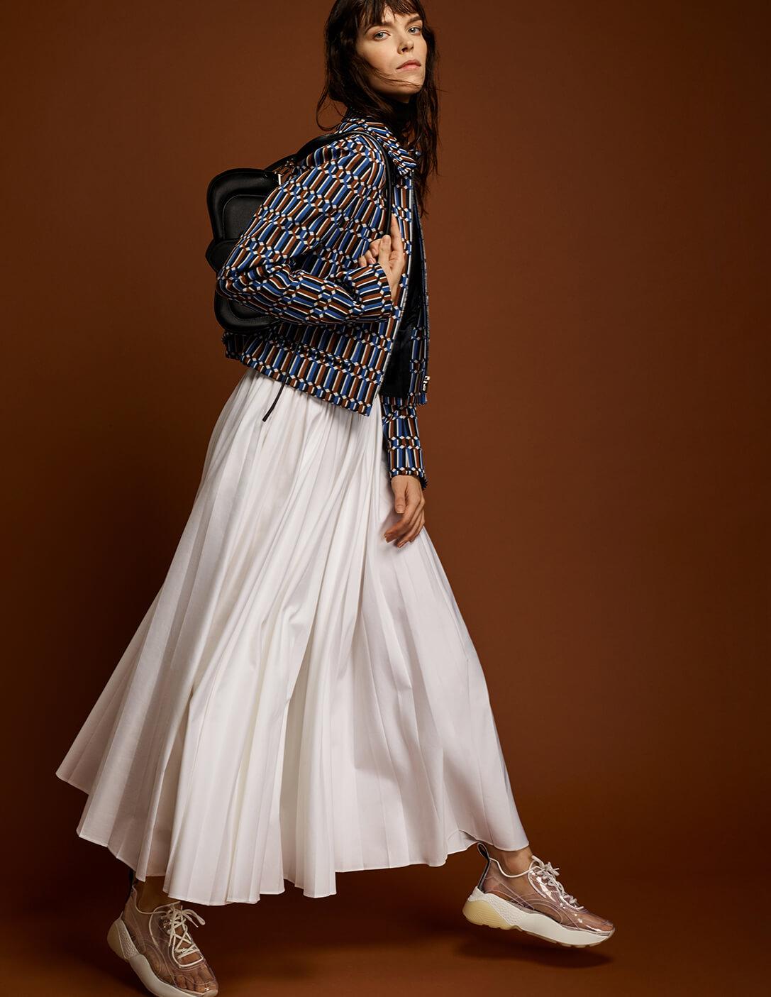 Prada model with white skirt